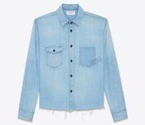 oversize-bluse aus ausgebleichtem blauem denim mit property-print