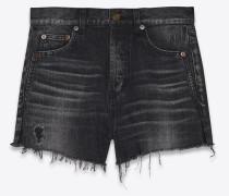 Used-look shorts in dark black denim