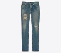 Blaue Skinny-Jeans mit Dirty-Sandwaschung