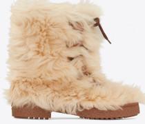 Fellstiefel aus beiger Wolle und cremefarbenem Leder