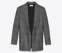 Lange Jacke mit Glencheck-Muster in Schwarz und Weiß.