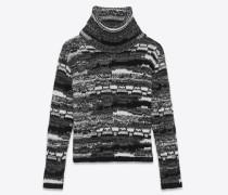 rollkragenpullover aus schwarzem, weißem und grauem patchwork-strick
