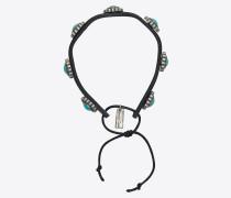 Geknotetes Armband aus Leder und Metall mit mehreren Cabochons