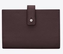 kompaktes sac de jour portemonnaie aus narbenleder in black tulip