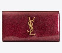Großes Portemonnaie aus pinkglänzendem Lackleder