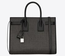 Kleine Sac du Jour Tasche aus schwarzem Leder mit silberfarbenen Nieten und Ösen