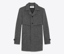 mantel aus grauer und schwarzer schurwolle mit fischgrätenmuster mit sturmsattel