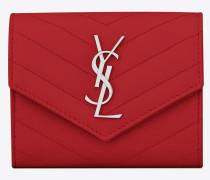 kompaktes portemonnaie aus rotem strukturleder mit metalassé-nähten und rundumreißverschluss