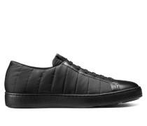 Niedriger Sneaker aus Gewebe und Leder