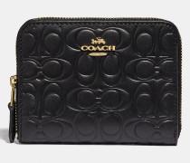 Kleines Portemonnaie aus charakteristischem Leder mit Rundum-Reißverschluss