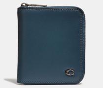 Kleines Portemonnaie mit RundumreiBverschluss und charakteristischen Metalldetails