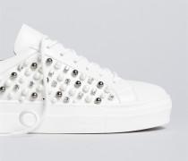 Sneakers mit Zierperlen und Nieten