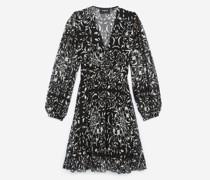 Kurzes elegantes Kleid mit Motiven und Schnürungen