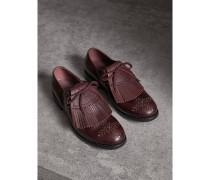 Nietenbesetzte Loafer aus Leder
