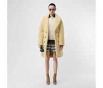Zweireihiger Oversize-Mantel aus Kunstlammfell