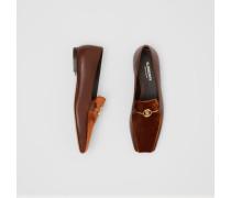 Loafer aus Leder mit Monogrammmotiv und Samtdetail