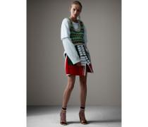 Rock aus Wolle im Uniformstil mit Lammfellbesatz