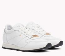 Leder-Sneaker mit sternförmigen Nieten