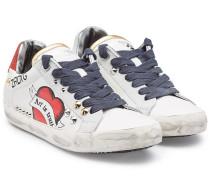 Sneakers aus Leder mit Glitter und Nieten