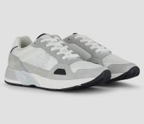 Sneakers aus Techno-stoff und Veloursleder mit Monogramm Seitlich