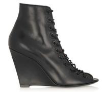Bondage wedge sandals in black leather