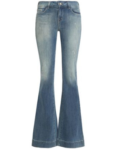 Distressed low-rise flared jeans