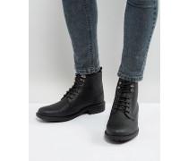 Geschnürte Stiefel in Schwarz mit gefrästem Design