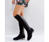 Kniehohe flache Stiefel aus Wildleder