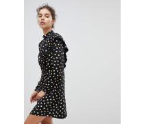 Gepunktetes Kleid mit Rüschen und hohem Halsausschnitt
