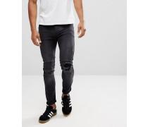 Enge Stretch-Biker-Jeans mit Knierissen und Flicken
