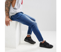 Enge Jeans in blauer Stone-Waschung