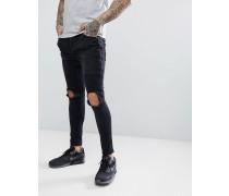enge Biker-Jeans mit Reißverschluss und aufgerissenen Knien
