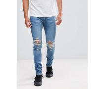 Skinny-Jeans mit Rissen und Reißverschluss