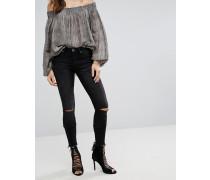 Hoodlums - Enge Jeans mit mittelhoher Taille Rissen an den Knien und grobem Saum