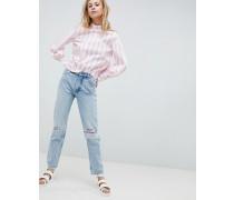 Kimomo - Jeans mit aufgerissenen Knien und aufgesticktem Slogan