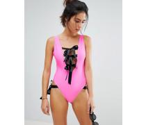 80s - Badeanzug in Neonrosa mit farblich abgesetzten Schleifen