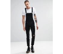Ira - Enge Jeans mit Latzdesign und Zierrissen in Schwarz