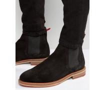Chelsea-Stiefel aus schwarzem Wildleder mit roter Ziehlasche