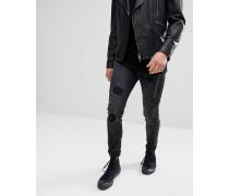 Skinny-Jeans mit Einsätzen und Zierrissen