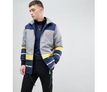 Trainingsjacke mit Farbblockdesign und bedrucktem Einsatz hinten in Blau