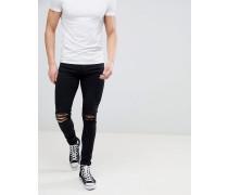 Leroy - Enge Jeans mit Knierissen in Schwarz
