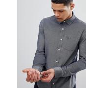 Marineblau meliertes schmales Piqué-Hemd mit kleinem Logo