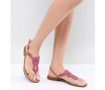 Flache Sandalen mit Verzierung
