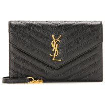 Clutch Monogram aus Leder