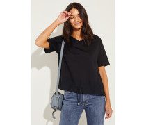 Baumwoll-Shirt mit Tunnelzug Schwarz- Shirt in Schwarz - V-Ausschnitt - Kurze Ärmel - Ausgestellte Silhouette - Seideneinsatz am Saum - Mit Tunnelzug - Auf Gesäßhöhe endend Größe des Models: 175 cm Material 1: -