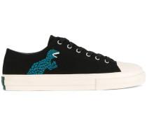 Sneakers mit Dinosauriermotiv
