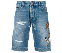 Tiger patch denim shorts