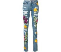 rose patch distressed skinny jeans