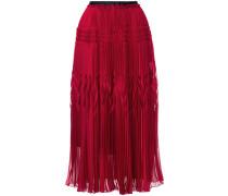 high-waisted pleated skirt