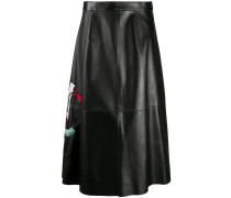 face-embroidered leather skirt
